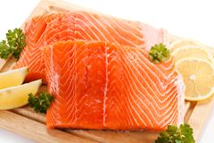Fresh raw salmon fillet on cutting board. On white background Stock Image