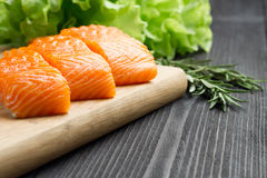 Fresh raw salmon fillet on cutting board. Fresh raw salmon fillet on cutting board with seasonings Stock Photo