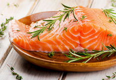 Fresh raw salmon fillet on cutting board. Selective focus Stock Photo