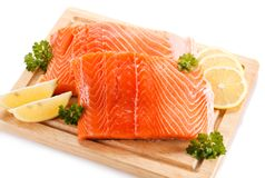 Fresh raw salmon fillet on cutting board. On white background Stock Photo