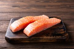 Fresh raw salmon fillet, flat lay. Fresh raw salmon fillet. Old wooden background. Copy space. Selective focus Stock Photo