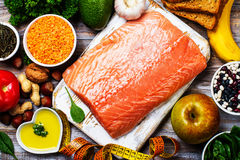 Fresh raw salmon fillet. And ingredients on kitchen table Royalty Free Stock Photo