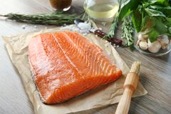 Fresh raw salmon fillet. On table Royalty Free Stock Photography