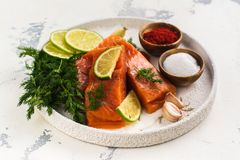 Fresh raw salmon fillet. On white kitchen table. Copy space Stock Photos