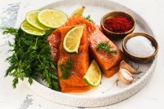 Fresh raw salmon fillet. On white kitchen table. Copy space Royalty Free Stock Image