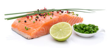 Fresh raw salmon fillet with herbs, lemon and spice Stock Image