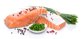 Fresh raw salmon fillet with herbs and spice. Isolated on white Stock Images