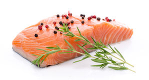 Fresh raw salmon fillet with herbs and spice. Isolated on white Stock Photo