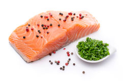 Fresh raw salmon fillet with herbs and spice. Isolated on white Stock Photography