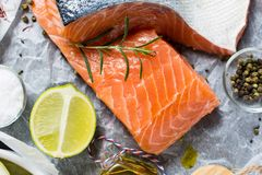 Fresh Raw Salmon Fillet and Ingredients for Cooking. Healthy Food. Raw Salmon Steaks and Ingredients for Cooking Stock Images