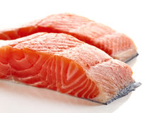 Fresh raw salmon fillet isolated on white. Background Royalty Free Stock Images