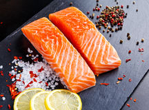 Fresh raw salmon fillet with lemon, herbs and spices. Fresh raw salmon fillet with lemon, herbs and spices Royalty Free Stock Photos