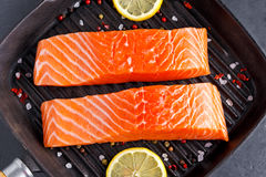 Fresh raw salmon fillet with lemon, herbs and spices. Fresh raw salmon fillet with lemon, herbs and spices Stock Image
