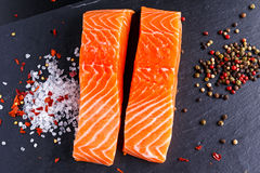 Fresh raw salmon fillet with lemon, herbs and spices. Fresh raw salmon fillet with lemon, herbs and spices Stock Photo