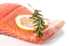 Fresh raw salmon fillet with lemon isolated on white Stock Photos