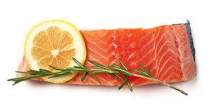 Fresh raw salmon fillet with lemon and rosemary isolated on whit Stock Photos