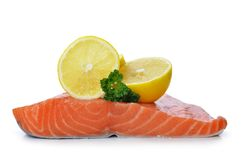 Fresh raw salmon fillet with lemons. Fresh raw salmon fillet with lemons isolated on a white background Stock Images