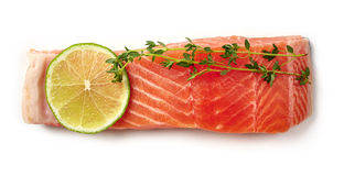 Fresh raw salmon fillet with lime and thyme isolated on white, f Royalty Free Stock Images