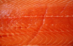 Fresh raw salmon fillet in market. Fresh raw salmon fish fillet on display in outdoor market for sale in Nice, France Stock Photography