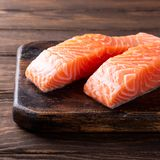 Fresh raw salmon fillet, flat lay. Fresh raw salmon fillet. Old wooden background. Copy space. Selective focus Royalty Free Stock Photos
