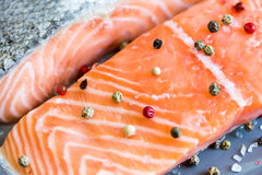 Fresh Raw Salmon Fillet with Peppers. Detail of Fresh Raw Salmon Fillet with Peppers Royalty Free Stock Photo