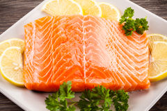 Fresh raw salmon fillet. On plate Royalty Free Stock Photos