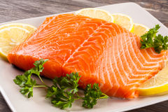 Fresh raw salmon fillet. On plate Stock Image