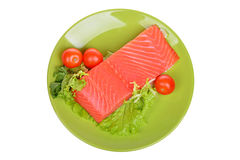 Fresh raw salmon fillet on a plate isolated. Over white background Royalty Free Stock Photos
