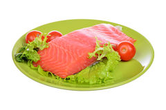 Fresh raw salmon fillet on a plate isolated. Over white background Stock Photo