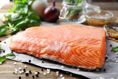 Fresh raw salmon fillet ready for marinating. On table Stock Photography