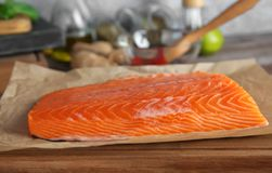 Fresh raw salmon fillet ready for marinating. On wooden board Stock Photos