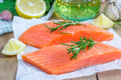 Fresh raw salmon fillet. With rosemary and lemon Stock Photos