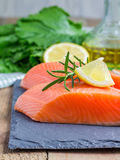 Fresh raw salmon fillet. With rosemary and lemon Royalty Free Stock Images