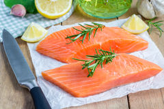 Fresh raw salmon fillet. With rosemary and lemon Royalty Free Stock Photos