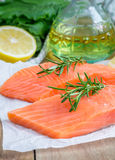 Fresh raw salmon fillet. With rosemary and lemon Royalty Free Stock Photography