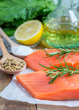 Fresh raw salmon fillet. With rosemary and lemon Stock Photo
