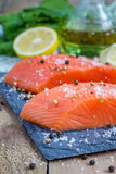 Fresh raw salmon fillet. With seasonings Royalty Free Stock Image