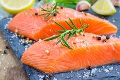 Fresh raw salmon fillet. With seasonings Stock Photos