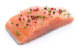 Fresh raw salmon fillet with spice. Isolated on white Royalty Free Stock Photos