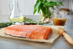 Fresh raw salmon fillet on table. Fresh raw salmon fillet ready for marinating on table Stock Photos