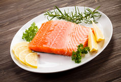 Fresh raw salmon fillet. On white plate Royalty Free Stock Image