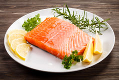 Fresh raw salmon fillet. On white plate Royalty Free Stock Images