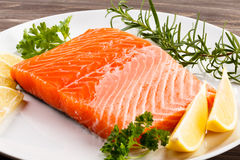 Fresh raw salmon fillet. On white plate Stock Photography