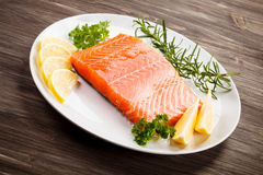 Fresh raw salmon fillet. On white plate Stock Photos
