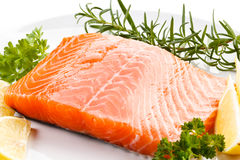 Fresh raw salmon fillet. On white plate Stock Images
