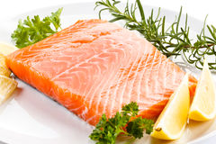 Fresh raw salmon fillet. On white plate Stock Photo