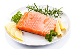 Fresh raw salmon fillet. On white plate Royalty Free Stock Photography