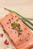 Fresh raw salmon fillet on wood background. Fresh raw salmon fillet on wood background Stock Images