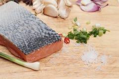 Fresh raw salmon fillet on wood background. Stock Photos