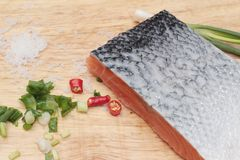 Fresh raw salmon fillet on wood background. Stock Images